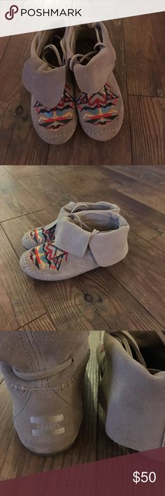 TOMS suede moccasin boots size 8.5 TOMS suede fold over ankle boots women's size 8.5. Moccasin style with colorful embroidery. Worn only a few times. Great condition although there is some splitting of leather ties (pictured). Fun boots for a fall day! Toms Shoes Moccasins
