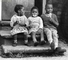 Children eating ice cream on Bold Street in Moss Side (1969)