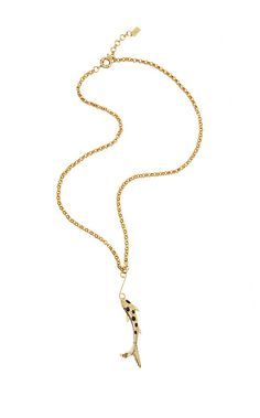 The Hooked on You Necklace is a gold metal necklace with a hook fish detail. Wear this on your next tropical vacation with a maxi dress and sandals.