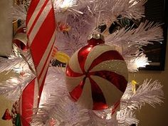I love themed Christmas trees and always have a few.  I could have one in every room, each with a different theme.  One of my daughters has done the red and white candy theme before, just like this.