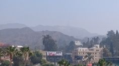 A view of the Hollywood sign through the smog