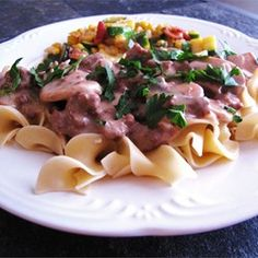 Easy Beef Stroganoff Recipe To get it to fit into my allotted calorie count for dinner: No egg noodles - steamed and chopped cauliflower works pretty well for putting under the beef mixture. One small can mushrooms 1 Tablespoon of butter 12 oz lean ground beef 1/4 cup sour cream All of the above are smaller measurements of the ingredients in the recipe.  With the changes, the per serving calorie count was 316 without the noodles or the cauliflower substitute.