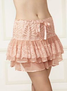 Vixie Lace Petticoat - Peach For the ultimate in girlie glamour look no further than the utterly beautiful Vixie lace petticoat. Inspired by ballerina chic, this ruffled petticoat in soft dusky pink features layers of delicate lace and sumptuous mesh trimmed with pink ribbon. The soft, silky lining and elasticated waist make for luxurious comfort, while the ribbon tie at the waist adds a sweet finishing touch.