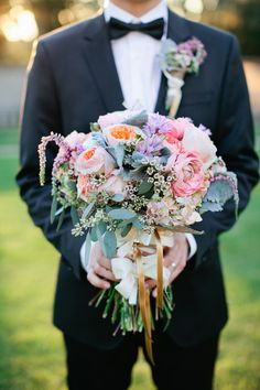 bright and colorful bouquet- peonies, roses, wax flower, astilbe, eucalyptus, and even succulents | Rooted Harmony