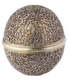Parcel-gilt Bezoar stone holder: c1680- Decorated with pierced and engraved silver scrollwork on a gilt ground.  The name bezoar stone is derived from the Persian word pa(d)zhar meaning 'antidote against poison'. According to legend, the bezoar stone was found   in the stomach of the unicorn and was prized by rulers for its protection against poison and illness.