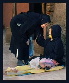 Marrakech, Morocco (caring woman asking for well being old) - a photo by Jan Hemels