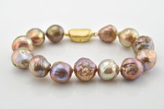 This bracelet features gorgeous lustrous Japan Kasumi baroque pearls. The pearls vary in size from and the bracelet measures in length. The pearls vary in iridescent metallic color fr Pearl Bracelet, Pearl Jewelry, Bangle Bracelets, Jewelery, Vintage Jewelry, Jewelry Accessories, Jewelry Design, Estilo Fashion, Baroque Pearls