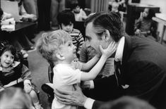 "Fred Rogers and Tommy.  Jim Judkis took the timeless photograph in 1978. Judkis took photos of Mister Rogers for nearly 25 years until Fred Rogers' death in 2003. It was his first assignment with Mister Rogers, and it was taken at what was then called the Memorial Home for Crippled Children, now renamed The Children's Institute, in Pittsburgh, where ""Mister Rogers"" was filmed."