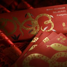 Uniquely designed red packets for Chinese New Year from Royal Selangor. When the four packets are assembled together, it forms a unique overall visual of three auspicious snakes coiling around a bamboo plant that spell out the numbers 2013.