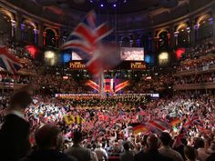 Audience members wave flags during the traditional finale to the Last Night of the Proms at the Royal Albert Hall
