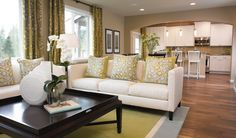 White sofas and accessories complement the white cabinets in the kitchen ~ Olympia, WA
