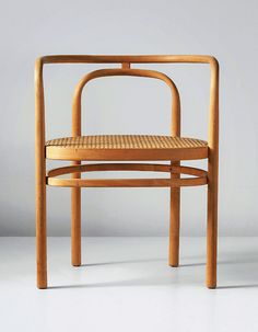 scandinaviancollectors:  POUL KJÆRHOLM, an early armchair, model no. PK 15, designed 1979, executed 1980.Beech, cane.Manufactured by E. Ko...