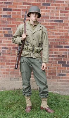 The basic US Infantryman uniform. He wears the jacket and HBT trousers o. The basic US Infantryman uniform. He wears the jacket and HBT trousers over his wool trousers. Photo courtesy of & the Front Milit. Military Gear, Military Photos, Military History, Military Jacket, Military Aircraft, Us Ranger, Us Army Uniforms, American Uniform, M1 Garand