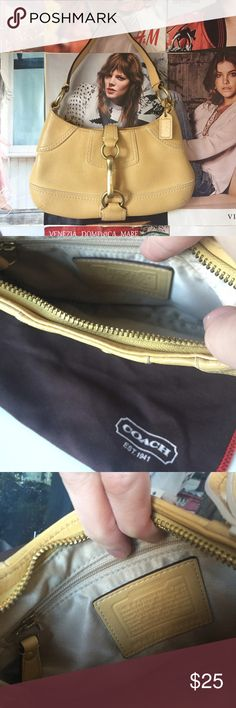 Coach   tan shoulder bag Tan shoulder bag from Coach. Gently used. Mark on strap as shown. Equestrian gold signature hardware. Coach Bags Shoulder Bags