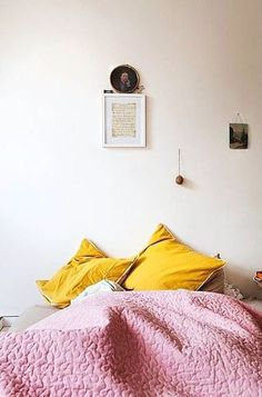 You guys. It's February, the days are dark, and I really need some color in my life right now. I saw the photo above pop up on my Pinterest feed, and it was an immediate panacea to my mood: rich mustard yellow and pale mauve-pink is an unexpected, invigorating, and straight-up cheerful combination. Read on for more examples and ideas for this surprising duo.