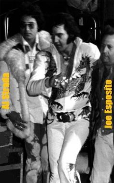 Elvis being escorted off stage by Joe Esposito Memphis Mafia, Elvis In Concert, Elvis Presley Photos, South Bend, Latest Albums, Norma Jeane, Graceland, Greatest Hits, No One Loves Me