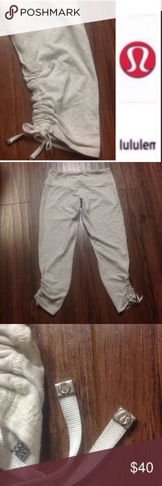 Lululemon crop pants with gathered sides In like new condition. Worn  lightly. No holes, stains or piles. Tag got cut off.                      d lululemon athletica Pants Ankle & Cropped