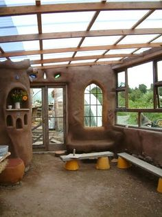Liked on Pinterest: Cob greenhouse....maybe do this as an addition to the main structure?