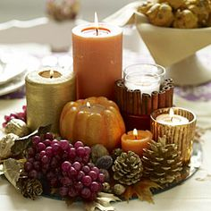 DIY - Autumn; Fall; Thanksgiving; Centerpiece:  Centerpiece made of plate, candles, cinnamon sticks, berries, pumpkin, leaves & pine cones.