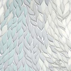 Cascade, a stone waterjet mosaic, shown in Tropical White, Infinity, Island Fog glass, and polished Snow White stone, is part of the Altimetry Collection for New Ravenna.