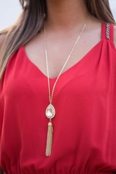 This tassel pendant necklace is a serious must-have! It goes with everrryyttthing and adds the right amount of glitz. :)