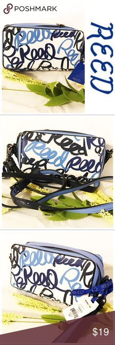"""Reed Gallery Wallet Crossbody Keep it small and travel light with this adorable blue and white faux leather Reed gallery wallet crossbody.  Two small compartments with zippered closures and pewter colored hardware.  Navy blue and light blue logo accent writing.  Detachable wrist strap and shoulder strap.  Gray cloth interior with several slip pockets.  Drop 24"""" Reed Krakoff Bags Crossbody Bags"""