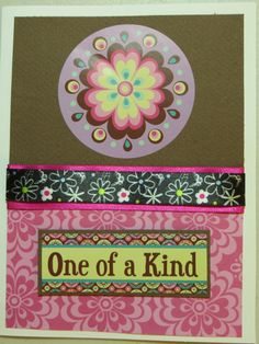 This is a handmade card with a sentiment sticker on the front of the card with embellishments and the inside of the card is blank.