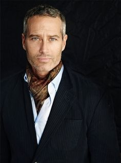 I typically am not a fan or men in scarves, unless it's 5 below, but this is classy and looks distinguished