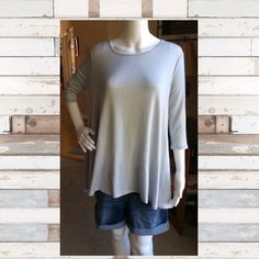 Summer top Soft and flowing summer top. 69% Rayon, 27% Polyester and 4 %'Spandex. Hand wash cold,hang or line dry Made in the USA Tops