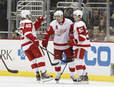 CrowdCam Hot Shot: Detroit Red Wings center Henrik Zetterberg and defenseman Adam Almqvist congratulate center Pavel Datsyuk after Datsyuk scored a goal against the Pittsburgh Penguins during the second period at the CONSOL Energy Center. Photo by Charles LeClaire