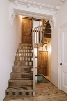 Tucked away in a residential corner of London, a spiralling staircase breathes a new life into an old home. Known as Marie's Wardrobe, the stairs are perforated by a screen of timber dowels, creating a breezy balustrade that allows for the passage of both air and light.