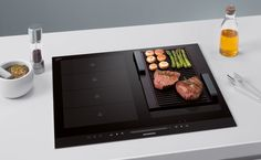 Flex induction and griddle combination from Siemens. Flex Induction hobs provide greater flexibility by heating pans of any size, positioned anywhere in the zone. FAB !   nestkitchens.co.uk