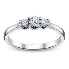 I really like this engagement ring...simple, three diamonds, and low set. :)