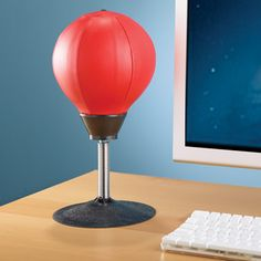 I need this. The Desktop Punching Bag: for the person working in the office who needs a little break now and then.