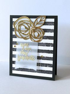 handmade freindship card by donna mikasa ... background of grungy wide black and white stripes ... gold foil die cut doodle flowers ... vellum banner with gold embossed sentiment ... great card!
