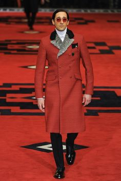 Adrien Brody, I'm in love.  Only you could make a red Versace trench coat and sunglasses look sexy!