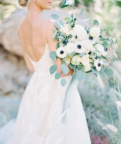 modern, natural bouquet with anemones and thistles - Melissa Jill Photography