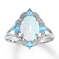 my new engagement from my husband, only 7 years late! Lab-Created Opal Ring Blue Topaz & Diamonds Sterling Silver