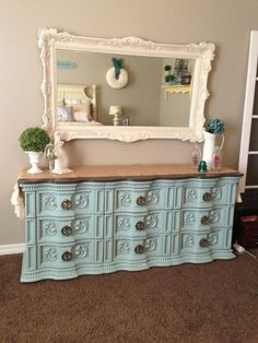 We have a gaudy gold mirror to repurpose that looks just like this. I will probably do a rustic black, same color as our dresser