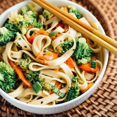Easy Sesame Broccoli Noodle Bowl- filled with crunchy broccoli, red peppers and toasted sesame seeds. Perfect for a quick lunch!