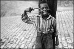 """Pittsburgh, Pennsylvania, 1950. """"This is another favorite early photo of mine taken in Pittsburgh in 1950. Its shows a black boy with a gun to his head. Again, it's a picture, but you can make out of it whatever you wish. I was there working for Roy Stryker, documenting Pittsburgh as it was about to experience big change. The entire point of Pittsburgh was being demolished for new buildings and Roy (who worked for the FSA) hired me, along with a lot of other photographers, to document it."""""""