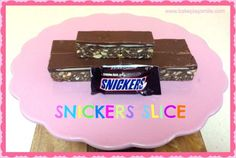 The Ultimate Snickers Slice - this quick and easy no-bake chocolate slice is packed with chopped up Snickers Bars and extra peanuts. umm yes please! Scroll down to the bottom of this post for my No Bake Desserts, Delicious Desserts, Yummy Food, Chocolates, No Bake Slices, Chocolate Slice, Chocolate Recipes, White Chocolate, Truffles