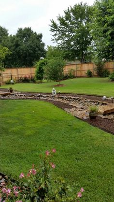 Our dry creek bed looks beautiful surrounded by the green, green grass. ..