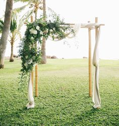 Nature inspired, greenery floral arch for wedding ceremony backdrop