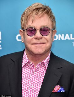 Bold: The vibrant singer showed off his bright character in a polka dot shirt and a bright pocket square  Read more: http://www.dailymail.co.uk/tvshowbiz/article-3007347/Lady-Gaga-supports-Sir-Elton-John-David-Furnish-honoured-glamorous-fundraiser.html#ixzz3VDYe9CA8  Follow us: @MailOnline on Twitter | DailyMail on Facebook
