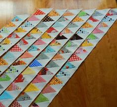 In a recent post , I shared with you an easier way to create the colorful arrows in Denyse Schmidt's new pattern, Point me....         If y...