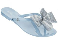 c8164ed012e4 Mini Melissa Harmonic Bow Flip Flop The Mini Melissa Harmonic Bow Flip Flop  Sandal is a glittery bow-trimmed seasonal favorite in durable rubber for a