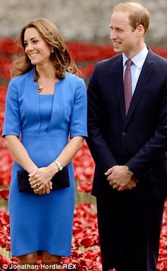 The Duke and Duchess of Cambridge smile at the Yeoman Warders -- Tower of London poppy WWI exhibit Aug. 2014