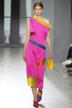 Christopher Kane Spring 2016 - Christopher Kane has long loved techno fabrications—remember those gel-filled collars from Fall 2011? For Spring, he spliced his bias-cut cocktail dresses with PVC inserts.