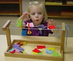 A miniature cloths line will encourage children to pinch a close pin and manipulate the felt pieces. Can build fine motor strength and skills